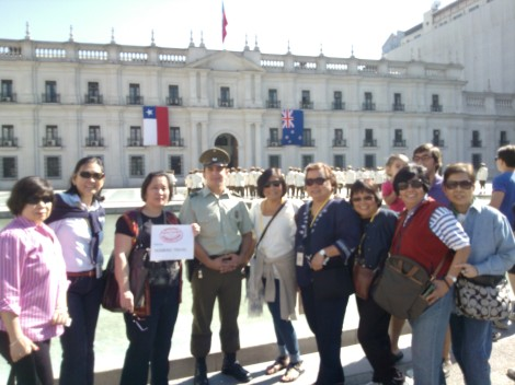 Travelers in front of Presidential Palace La Moneda Chile